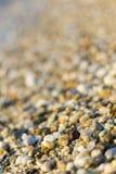 Pierres sur la plage et l'eau de mer Photo libre de droits