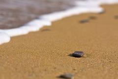 Pierres sur le sable Photographie stock libre de droits
