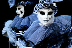 Pierrot on black background. Two people dressed as Pierrot on black background, during the Venice Carnival royalty free stock photo