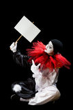 Pierrot with blank sign Stock Images