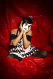 Pierrot Clown sitting on floor. Stock Photography