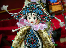 Pierrot doll at a souvenir stall in Saint Petersburg, Russia. Pierrot doll horizontal portrait, beautiful artisan toy, with painted wooden face, and colorful Royalty Free Stock Photo