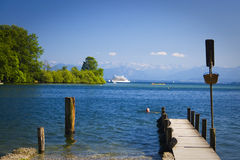 Piers and boat. View of piers and boat at Starenberger see in Bavaria Royalty Free Stock Images