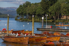 Piers and boats on edge of Bowness-on-Windermere in Lake Distric Royalty Free Stock Images