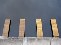 Piers on a lakeshore. Small piers fo scullers on a lakeshore Royalty Free Stock Images