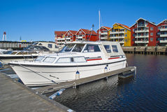 On the piers in the port of Halden (cabin cruiser) Stock Images