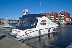On the piers in the port of Halden (cabin cruiser) Royalty Free Stock Photo