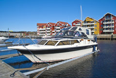 On the piers in the port of Halden (cabin cruiser) Royalty Free Stock Images