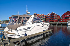On the piers in the port of Halden (cabin cruiser) Royalty Free Stock Photography