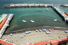 Piers of Sorrento. Piers extending out in the ocean with loung chairs and boats Stock Photo