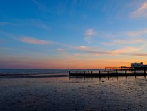 Piers at Sunset on the English Channel. Two piers on the shore of the English Channel at sunset in Bognor Regis, West Sussex, England stock photo