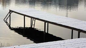 Pierwszy śnieg na molu zamarznięty jezioro Obrazy Royalty Free