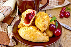Pies with cherry on board Royalty Free Stock Images