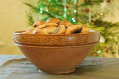 Pies clay bowl at the Christmas tree Royalty Free Stock Images