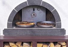 Pies are cooked in an old Russian oven. Russian wood stove royalty free stock photos