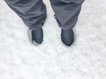 Pies de impresión en la nieve Fotografía de archivo libre de regalías