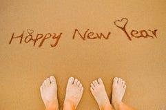 Pies de la Feliz Año Nuevo y del amante Foto de archivo libre de regalías