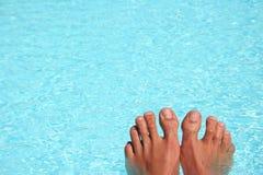 Pies de la piscina Imagen de archivo libre de regalías