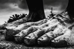 Pies de piedra de un rey Imagen de archivo