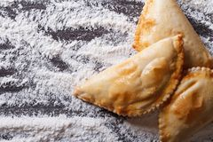 Pies empanadas closeup on a floured table. horizontal top view Royalty Free Stock Images