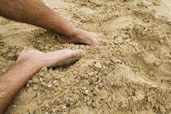 Pies en la arena Imágenes de archivo libres de regalías