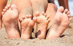 Pies en una playa Imágenes de archivo libres de regalías