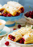 Pies From Puff Pastry With Cherry Stock Images