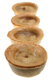 The Pies Have It. Meat and potato pies, isolated on white. Short DOF, focus on rear crust of first pie Stock Photo