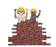 Pies i kot budowniczych mienia narzędzia w ich łapach Obrazy Stock