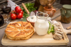 Pies, meat in aspic, dairy products. Pies, meat in aspic and organic dairy products Royalty Free Stock Photo