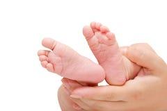Pies minúsculos del bebé Foto de archivo libre de regalías