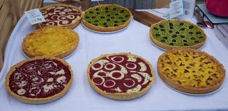 Pies with mushrooms, olives, raspberry, tomato sauce, cheese on a table. Top view. copy space stock photos