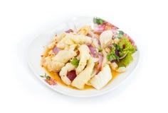Pies picantes de ensalada de pollo en el fondo blanco Foto de archivo libre de regalías