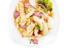 Pies picantes de ensalada de pollo en el fondo blanco Fotografía de archivo