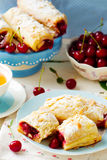 Pies from puff pastry with cherry Stock Image