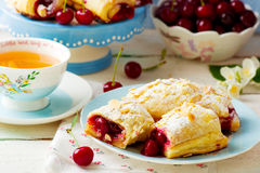 Pies from puff pastry with cherry Royalty Free Stock Photos