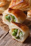 Pies of puff pastry with green peas close up  vertical Royalty Free Stock Image