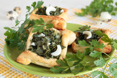 Pies of puff pastry with parsley, dill, chives Royalty Free Stock Image
