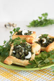 Pies of puff pastry with parsley, dill and quail eggs Royalty Free Stock Image