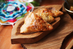 Pies samosas with vegetables on a wooden board still life in Royalty Free Stock Image