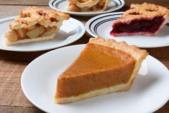 Pies Slices on Plates Stock Photo