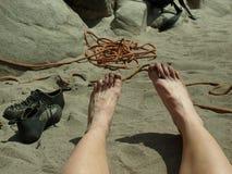 Pies sucios en la arena Imagen de archivo libre de regalías