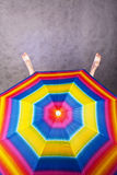 Pies y paraguas del arco iris Foto de archivo