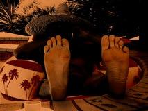 Pies y sombrero Fotos de archivo