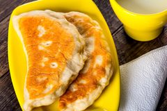 Patties on yellow plate Stock Photography