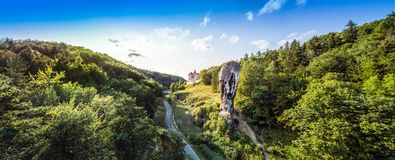 Pieskowa Skala Castle in beautiful surroundings, Krakow, Poland. Pieskowa Skala Castle and Hercules` mace  in Soluszowa, Poland Stock Images