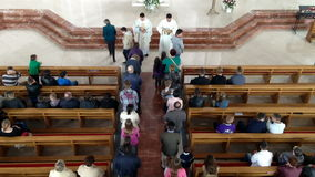 Piests distributing communion stock footage