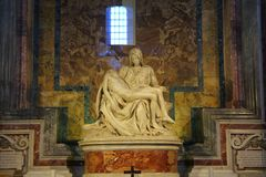 Pieta is a sculptural group in marble by Michelangelo in the Papal basilica of Saint Peter royalty free stock photo
