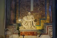 Pieta is a sculptural group in marble by Michelangelo in the Papal basilica of Saint Peter royalty free stock images
