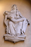 Pieta. Statue on the house facade in Florence, Italy Stock Photo